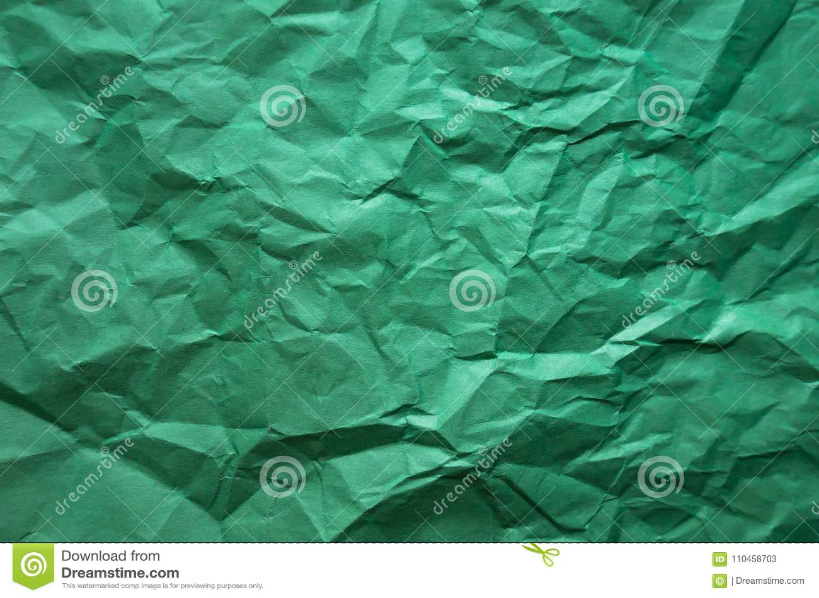 Bakgrund Skrynkligt grönt ark av papper