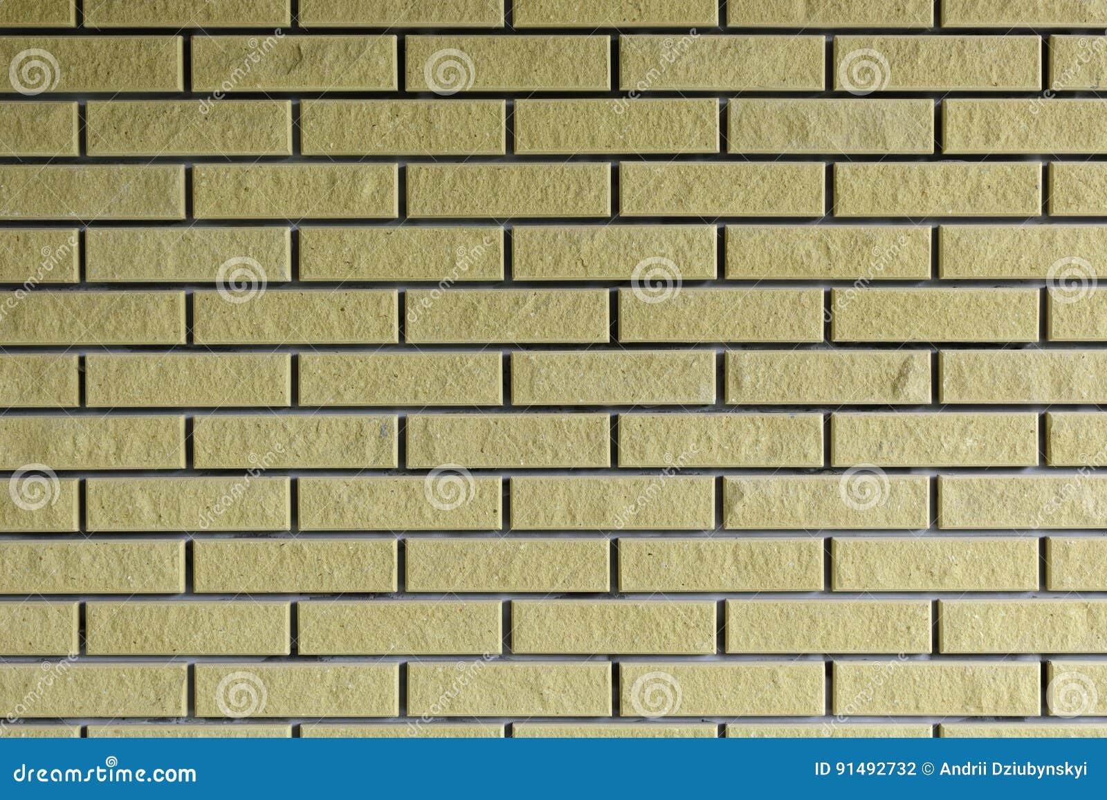 Bakgrund Tegelstenvägg av guling medf8ort
