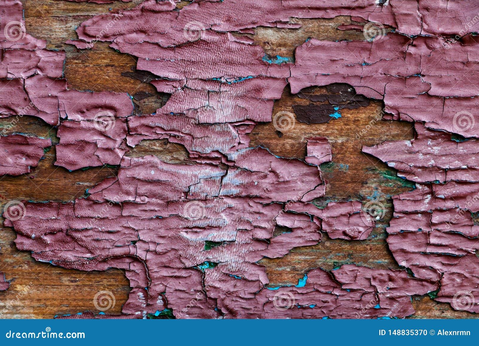 Bakgrund textur av det gamla träarket med skalning av målarfärg