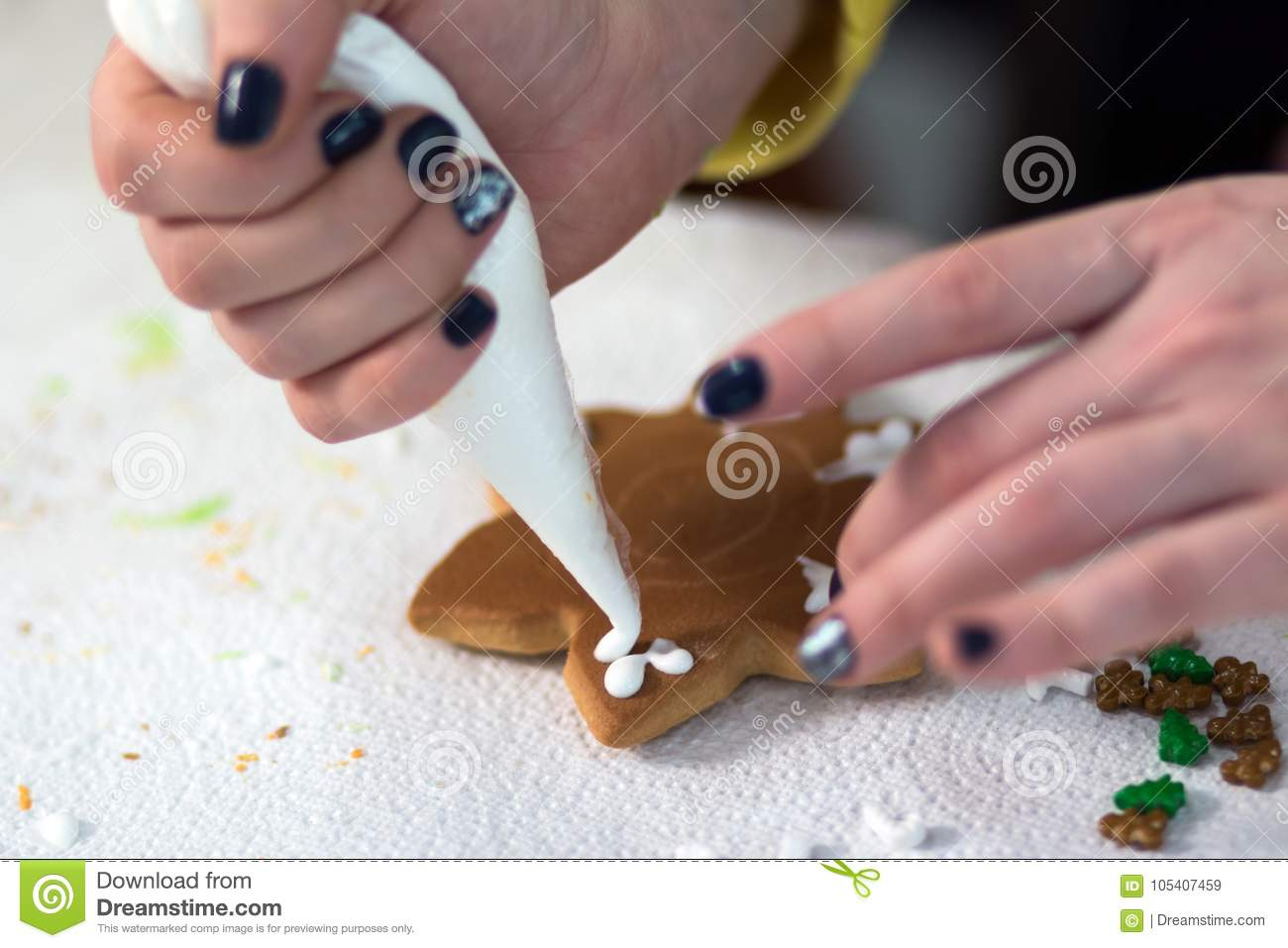 A Female Hand With Dark Nails Squeezes A White Glaze Cream For ...