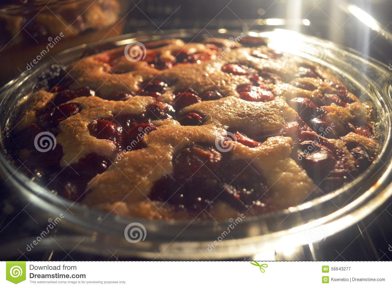 Baking Pie With Cherry In Oven Stock Photo - Image: 56643277