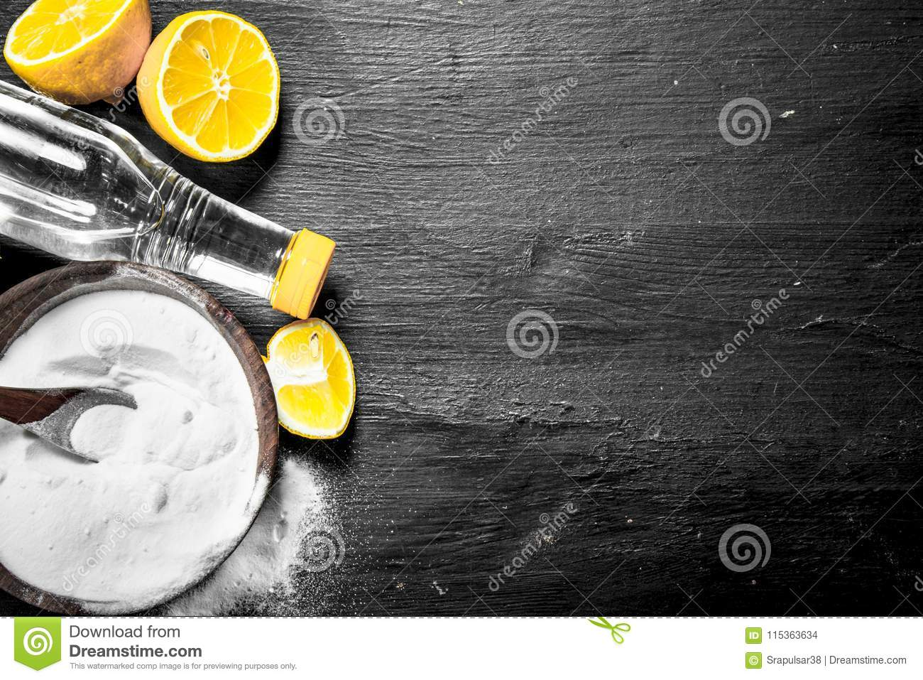 Baking Soda In A Bowl With Vinegar And Lemon Slices  Stock