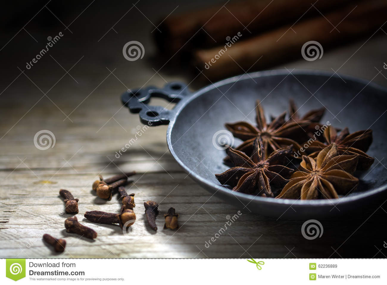 Baking Spices Star Anise Cinnamon And Cloves On A Rustic