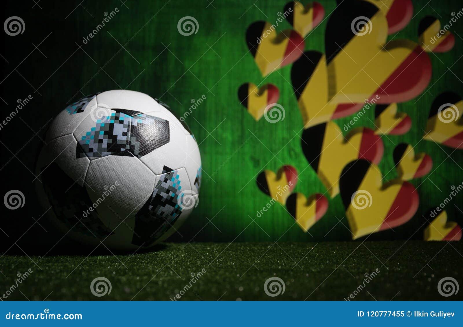 BAKU,AZERBAIJAN - JULY 08, 2018 : Creative concept. Official Russia 2018 World Cup football ball The Adidas Telstar 18 on green gr