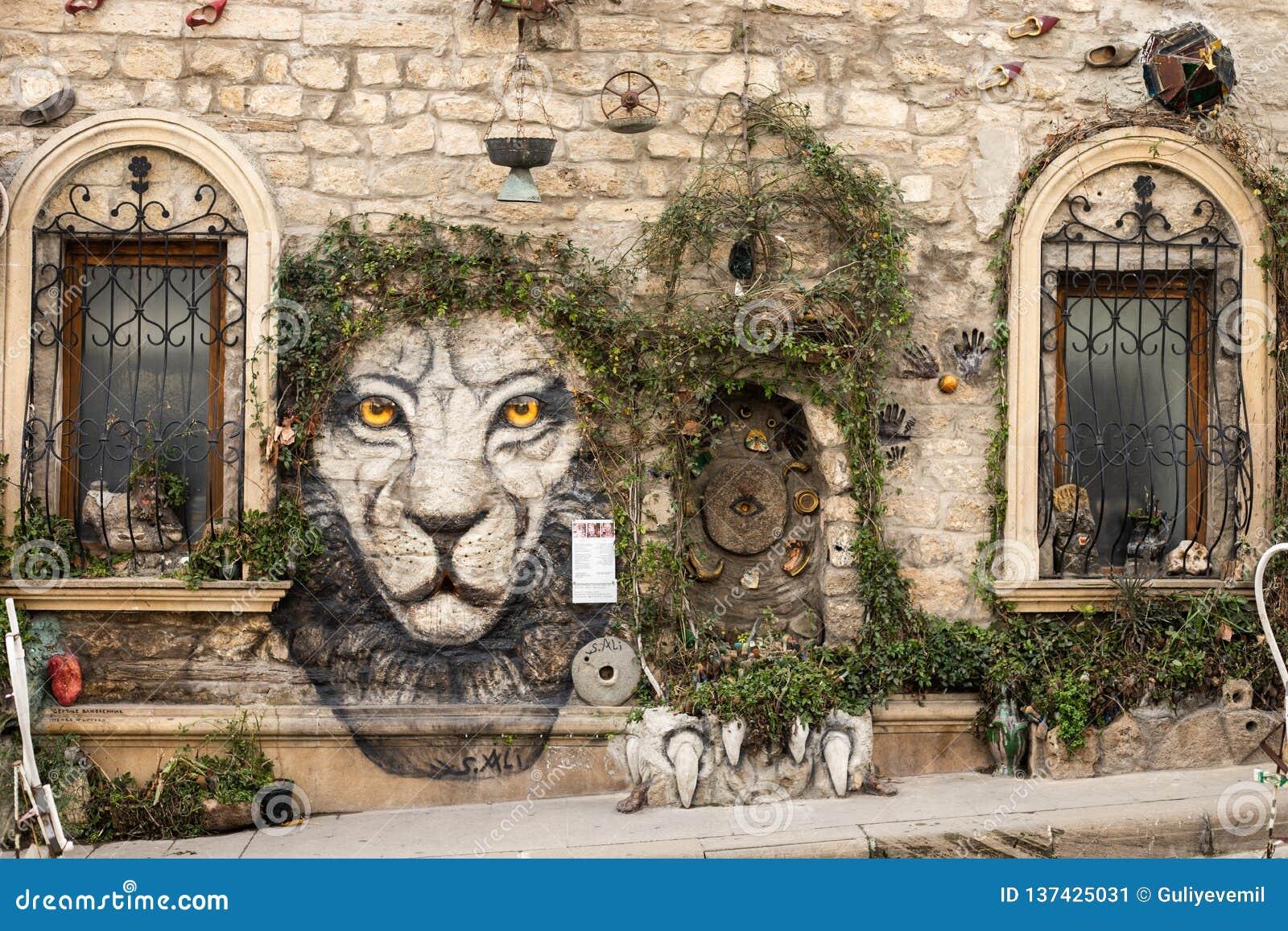 Baku azerbaijan old city. street art wall plant tree decoration. tiger face picture