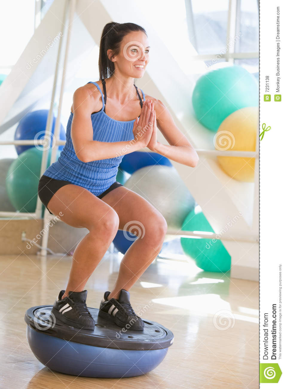 Balance gym trainer using woman