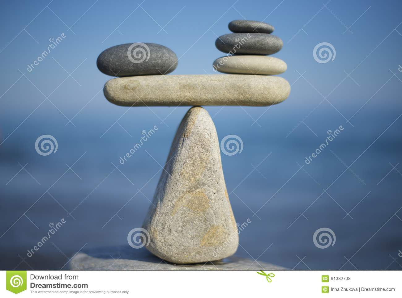 Balance of stones. To weight pros and cons. Balancing stones on the top of boulder. Close up.