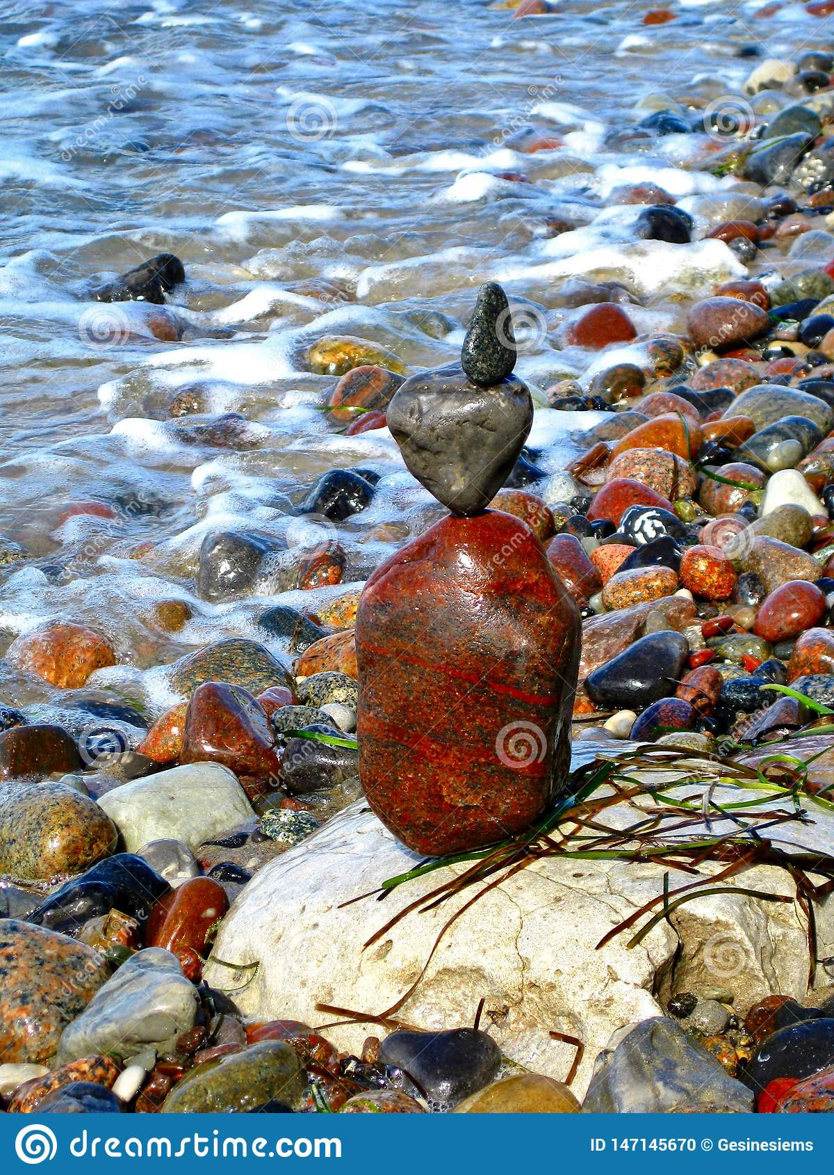 Balanced colorful stack of Stones on the coast