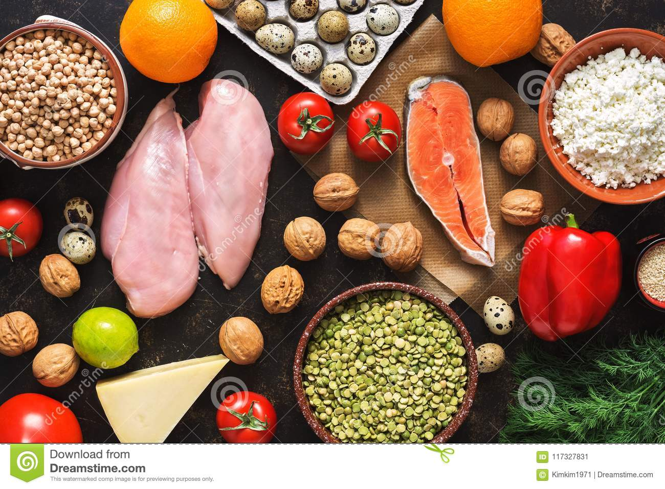 Balanced dietary products. The concept of healthy eating. Background of a healthy meal. Fruits, vegetables, salmon, chicken fillet