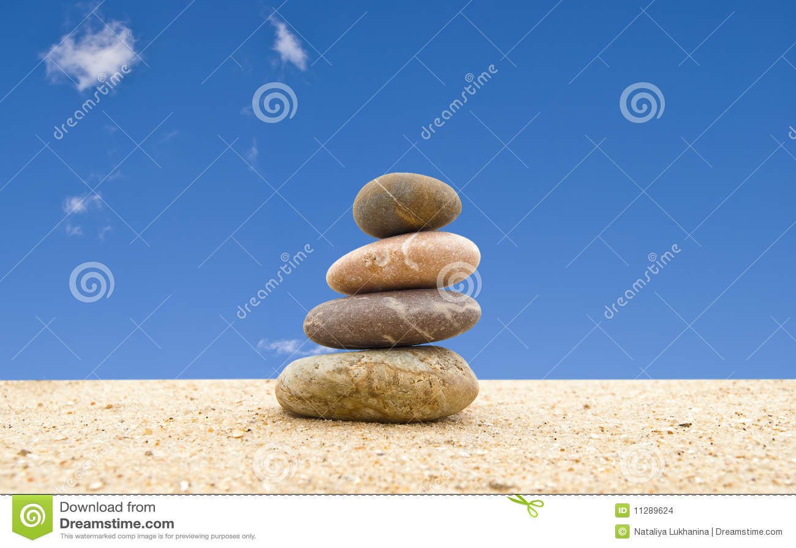 The balanced stones on sand