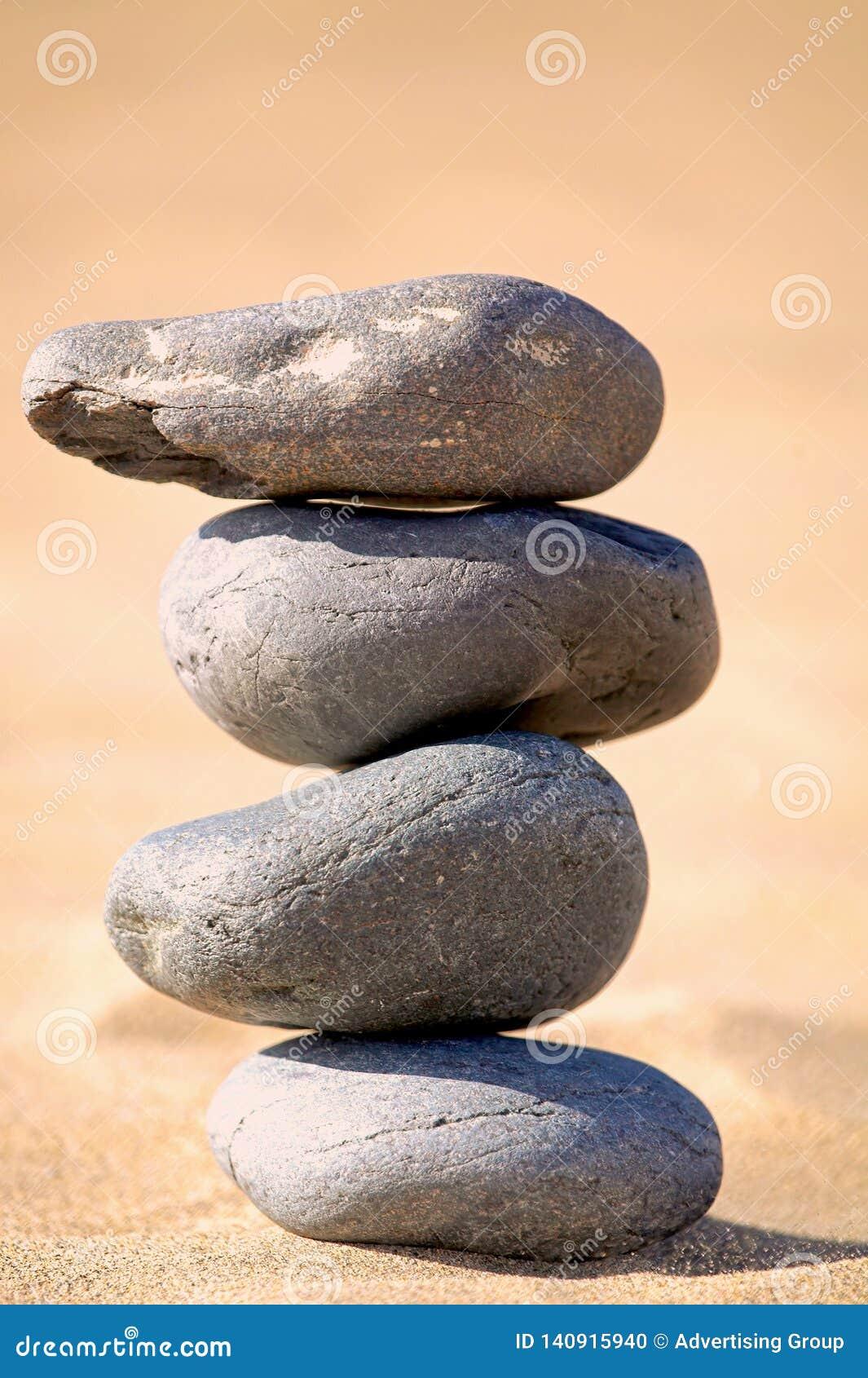 Balancing stones on a beach