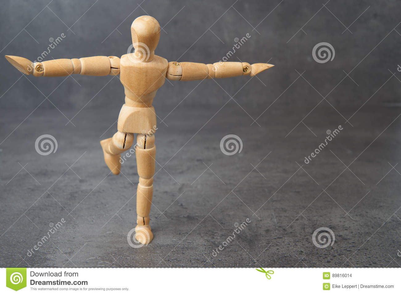 Balancing wooden mannequin, puppet, with copyspace