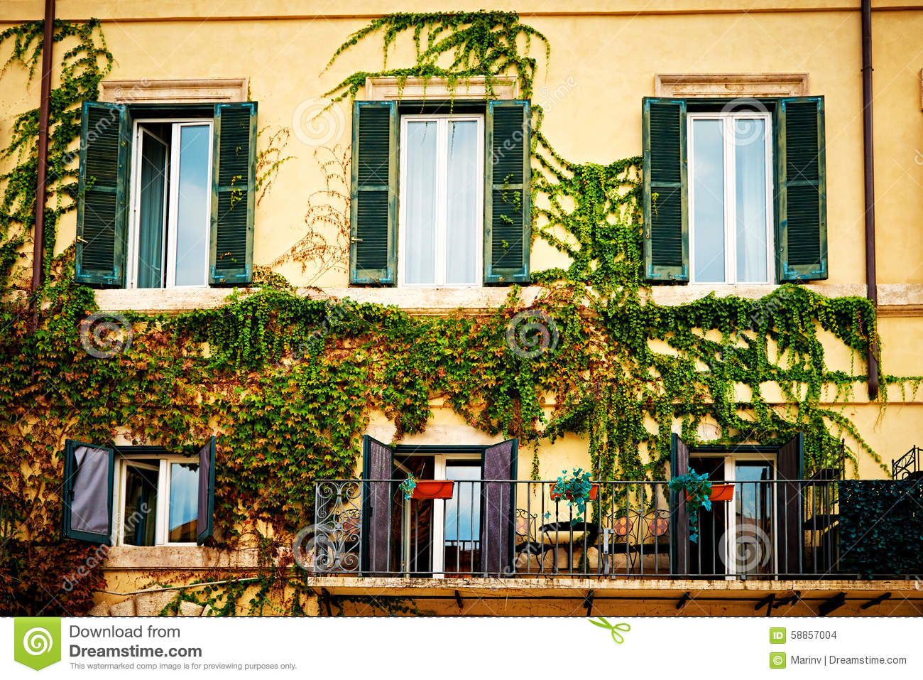 balconies full of flowers decorate houses in rome, italy stock