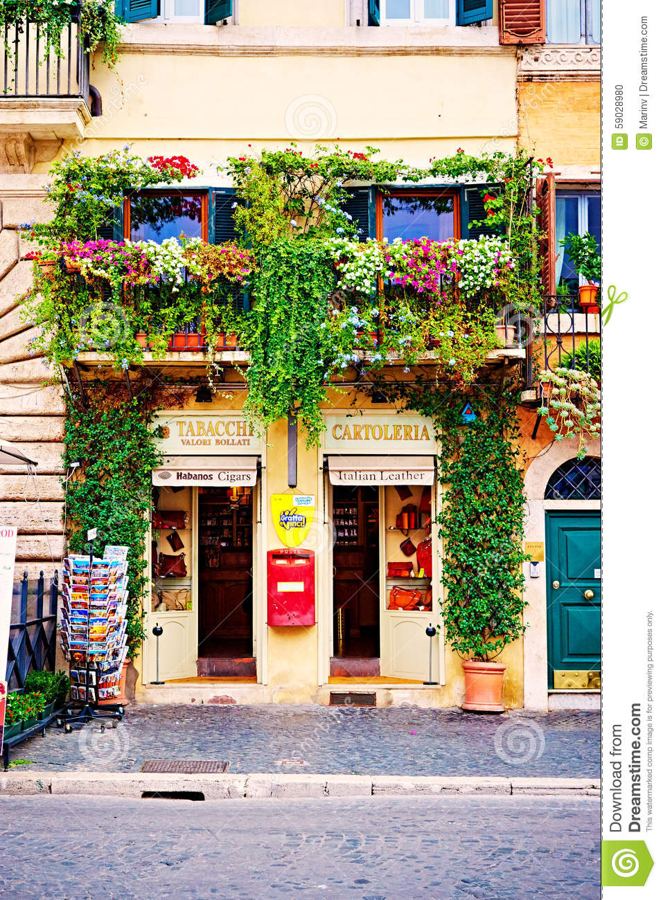balconies full of of flowers and greenery decorate houses and