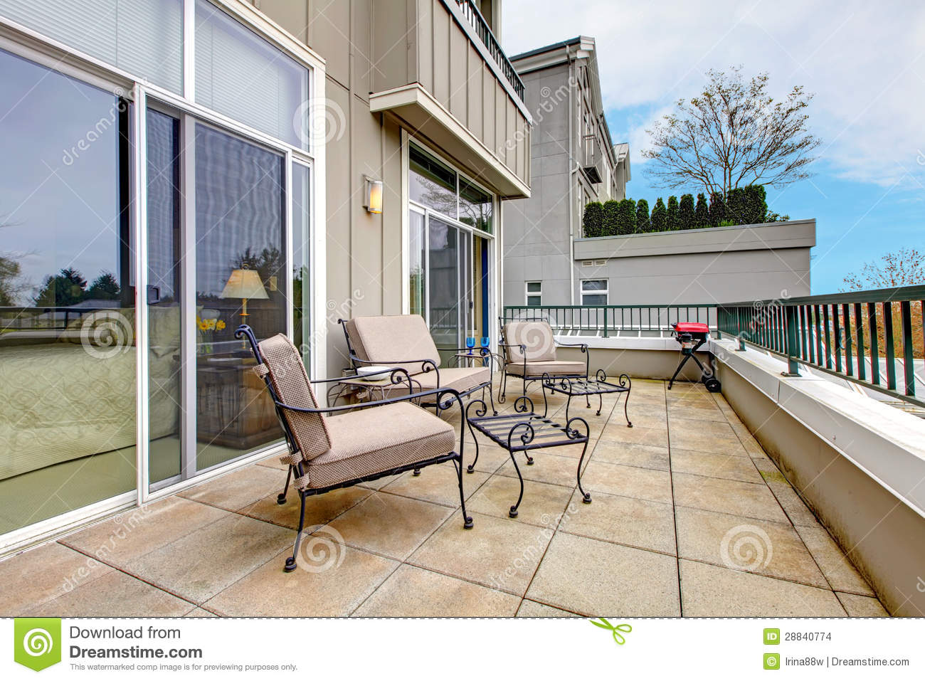 Balcony with furniture in new apartment building stock for Balcony apartments