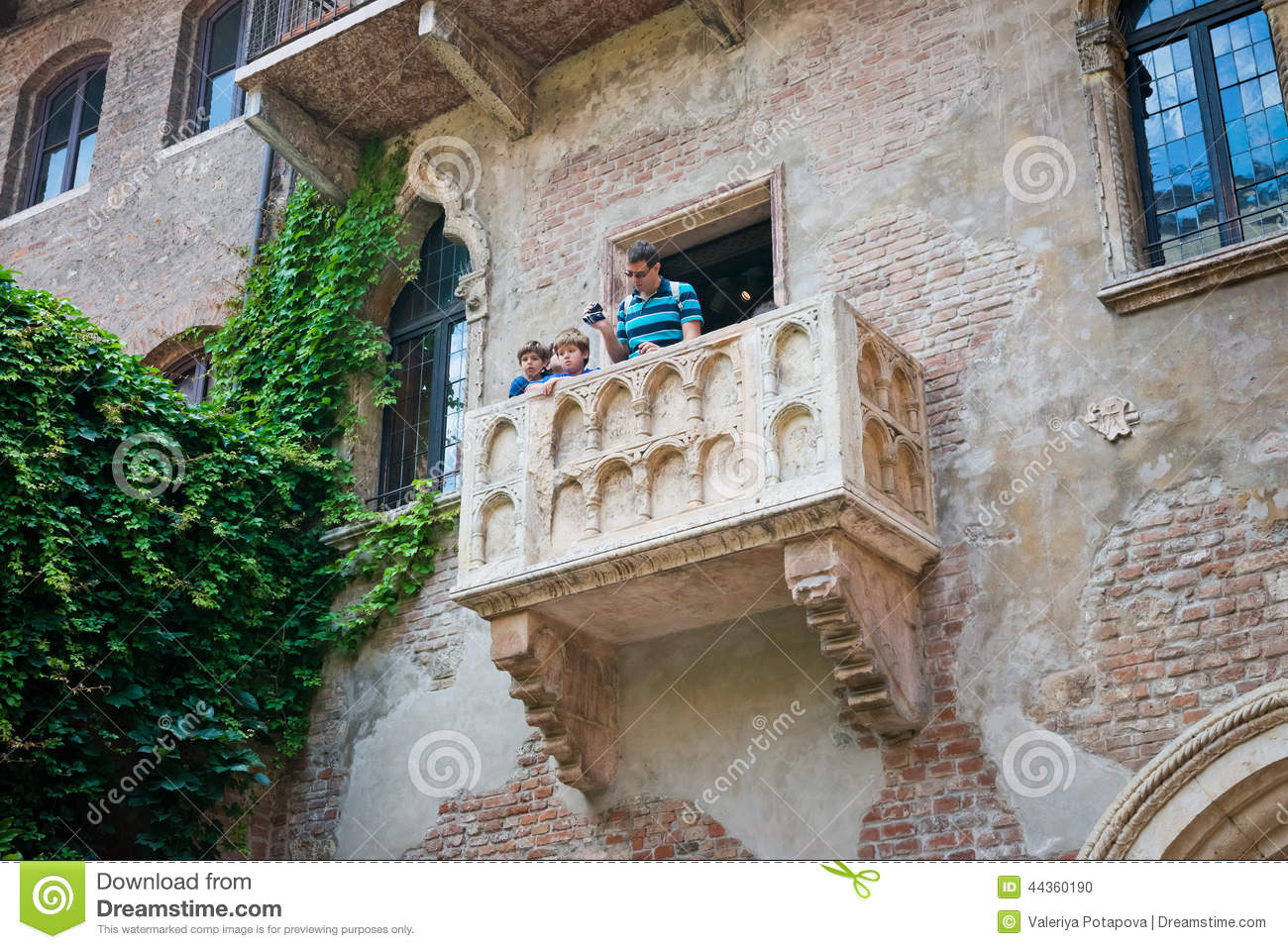 Balcony of juliet with turists in verona editorial image - i.