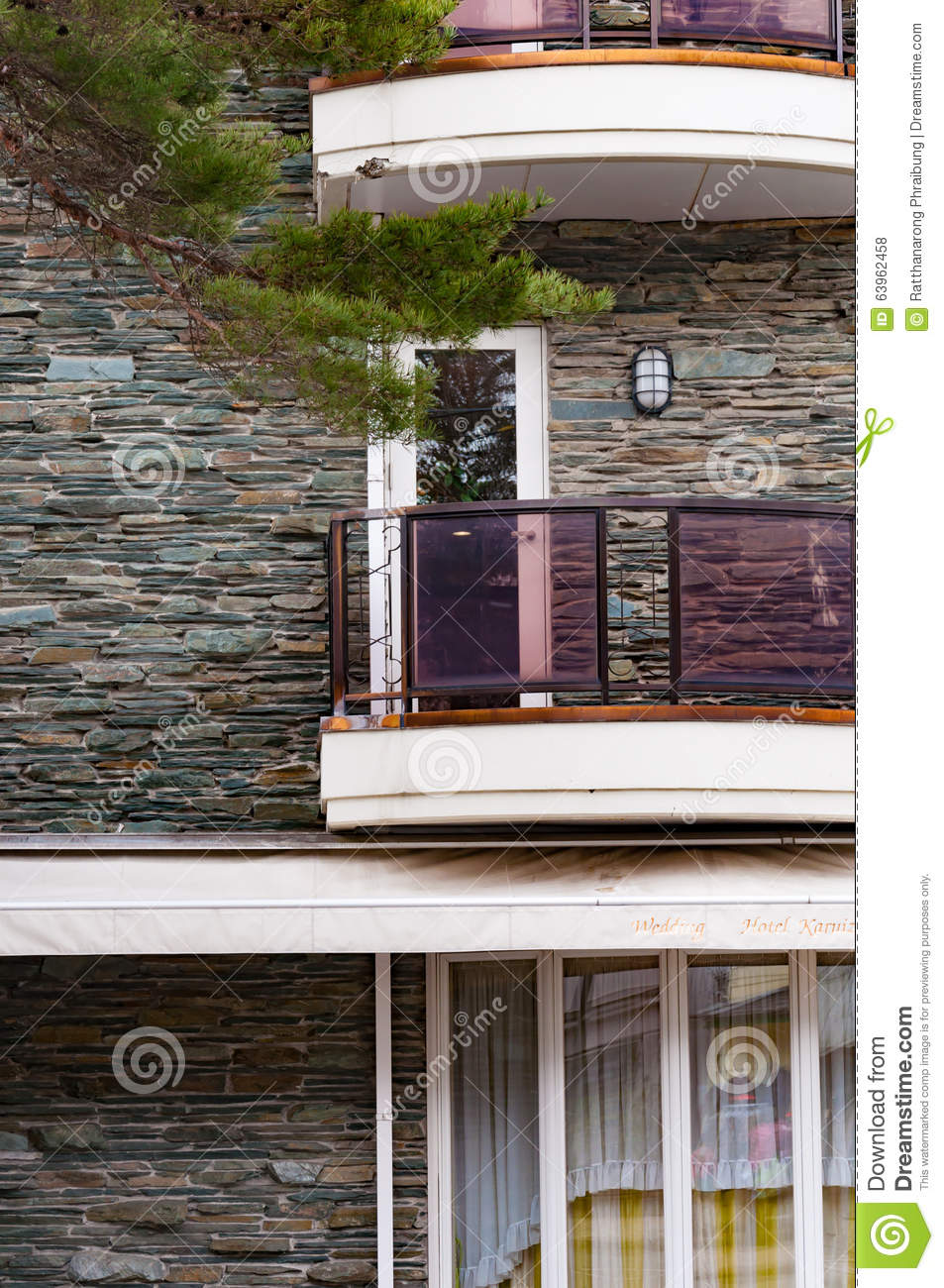 Balcony In Marble Wall : Balcony in modern building with stone wall stock photo