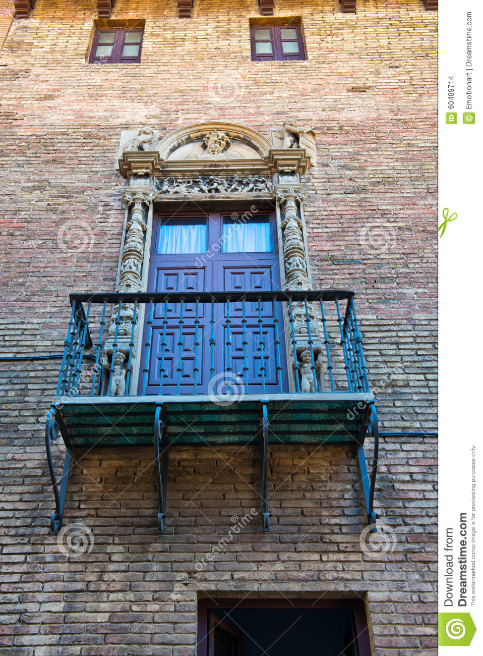 Balcony with ornate railing and door barcelona stock for Low balcony wall