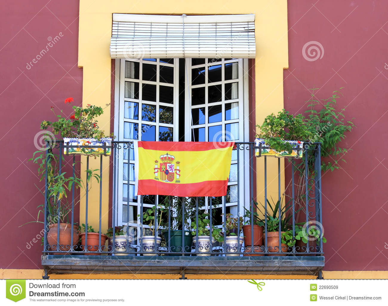 Balcony with spanish flag in seville spain stock image for Balcony in spanish