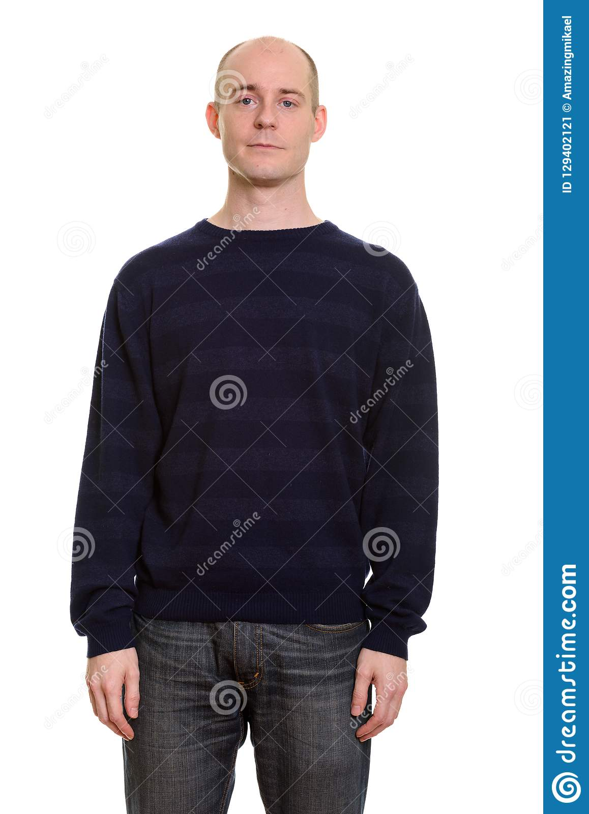 Bald Caucasian man standing and looking at camera. Bald Caucasian man isolated against white background stock image
