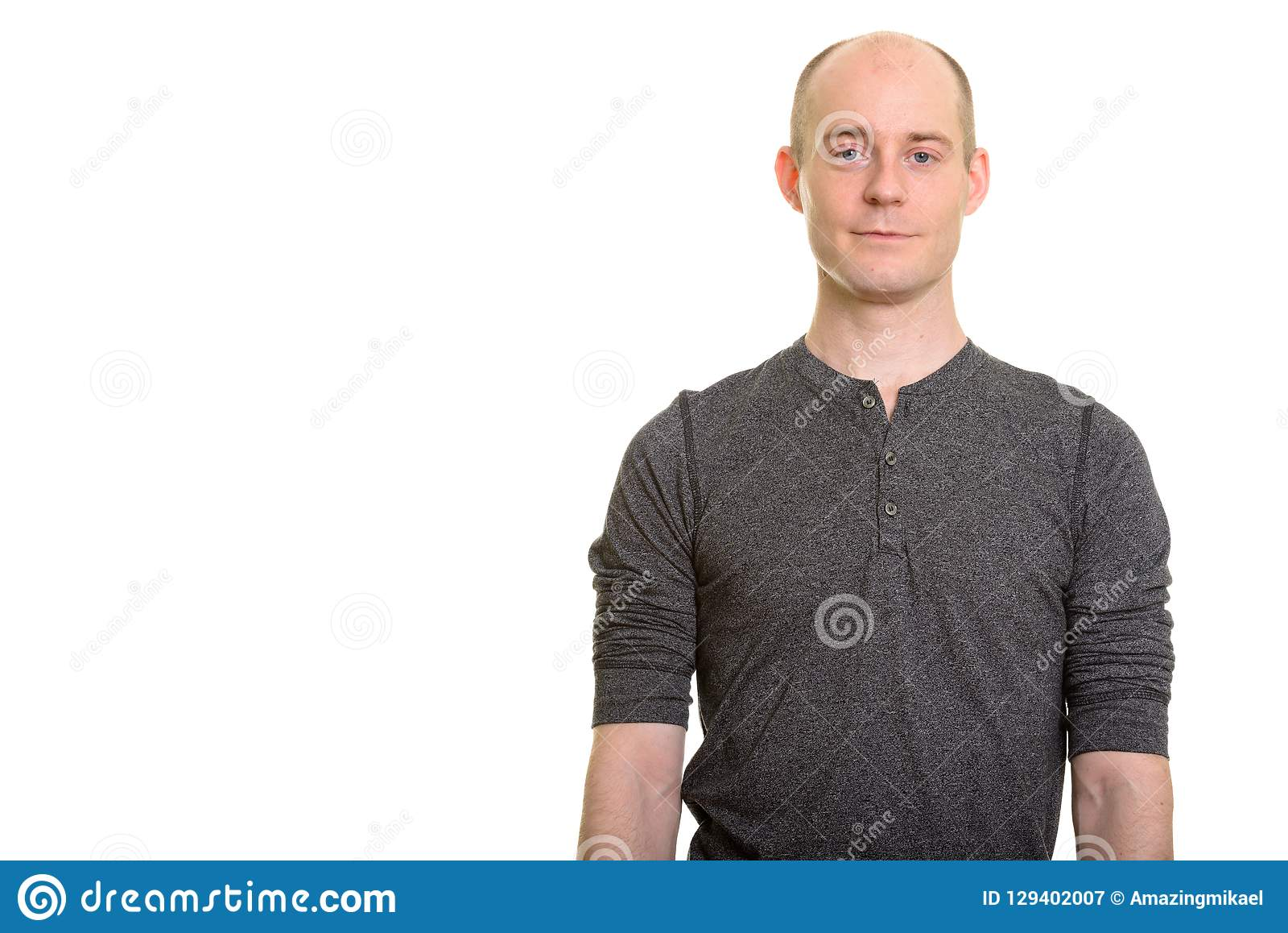 Portrait of balding Caucasian man looking at camera. Bald Caucasian man isolated against white background royalty free stock photography