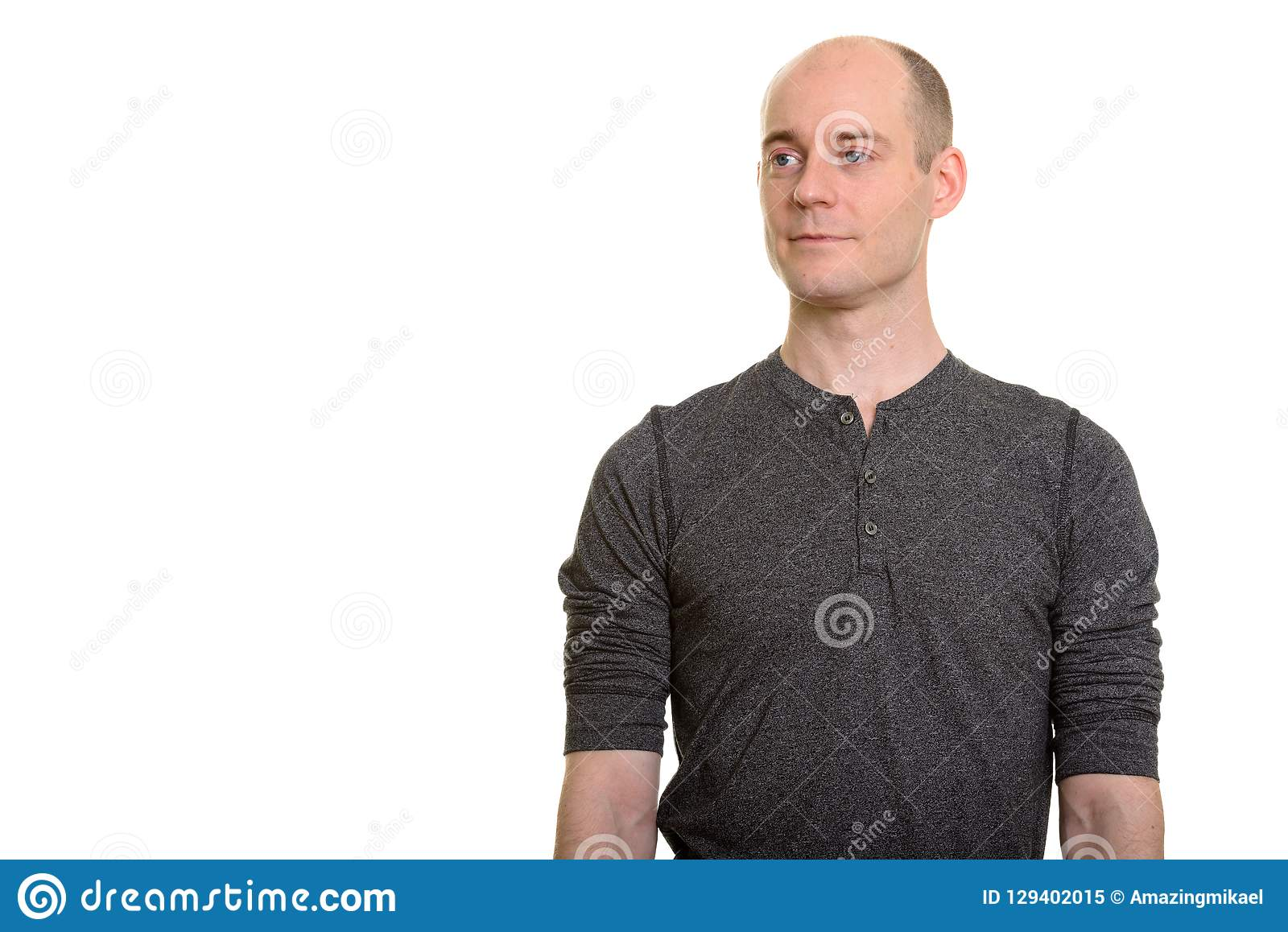 Bald Caucasian man thinking and looking away. Isolated against white background royalty free stock photo