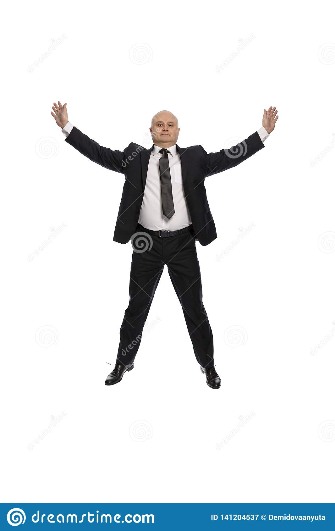 Bald middle-aged man in a suit jumping, businessman, isolated on white background