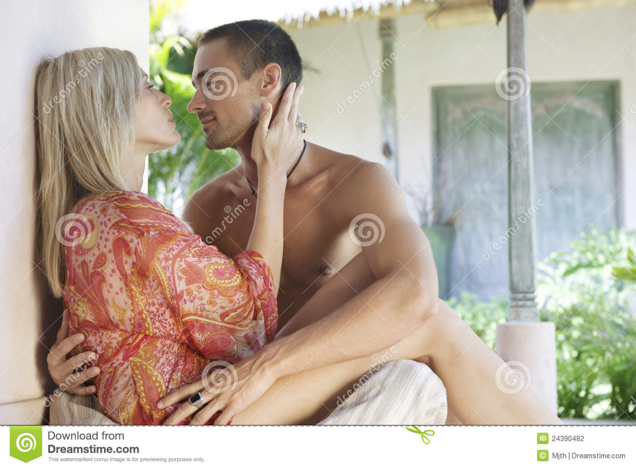 Bali 1 couple courtyard kissing stock photo image 24390482 for Luxury spa weekends for couples