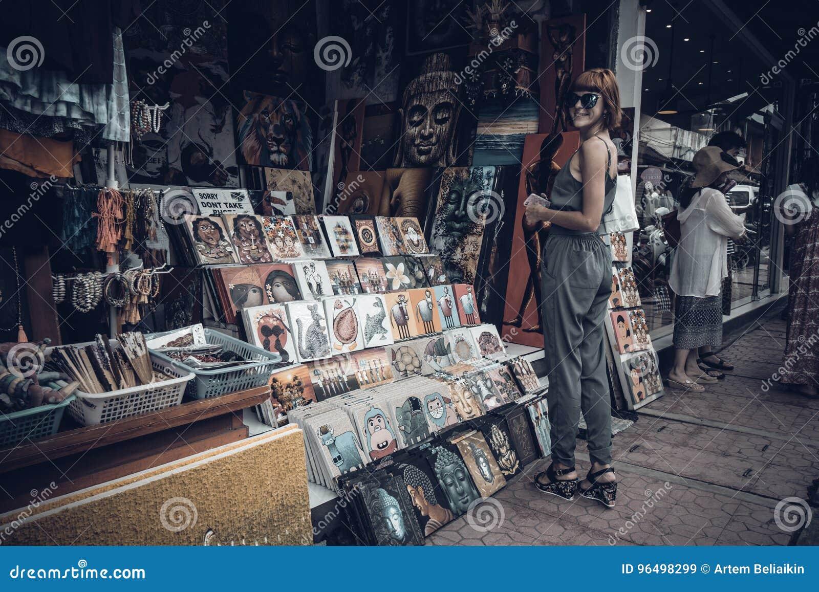 BALI, INDONESIA -JANUARY 1, 2017: Young woman on the souvenir street of Ubud, Bali, Indonesia.