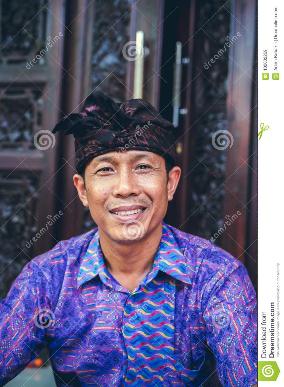 BALI, INDONESIA - OCTOBER 23, 2017: Close up portrait of balinese man. Bali, Indonesia.
