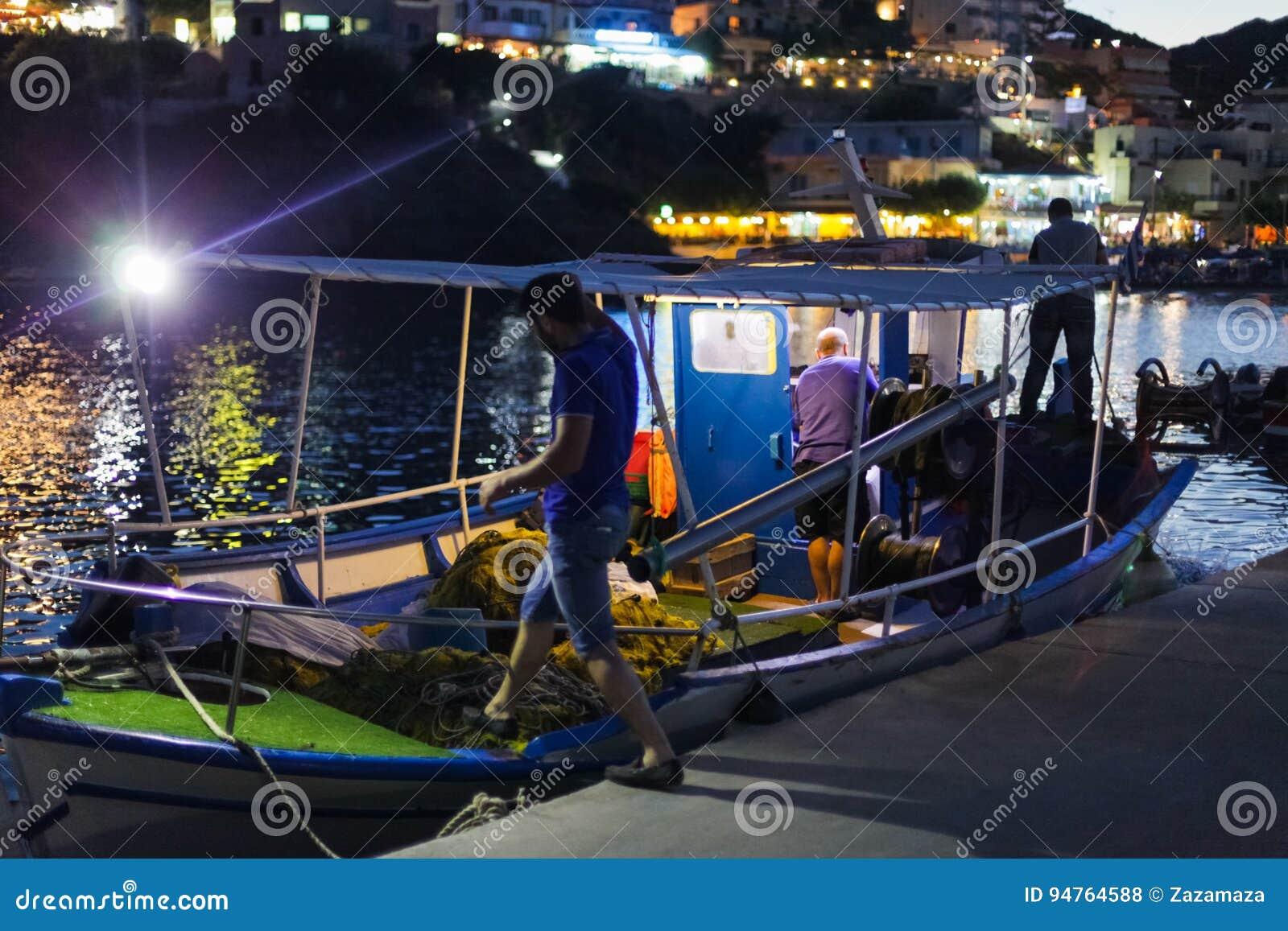 Bali, Island Crete, Greece, - June 30, 2016: Greek fishermen are leaving for night catching fish on the fishing boat