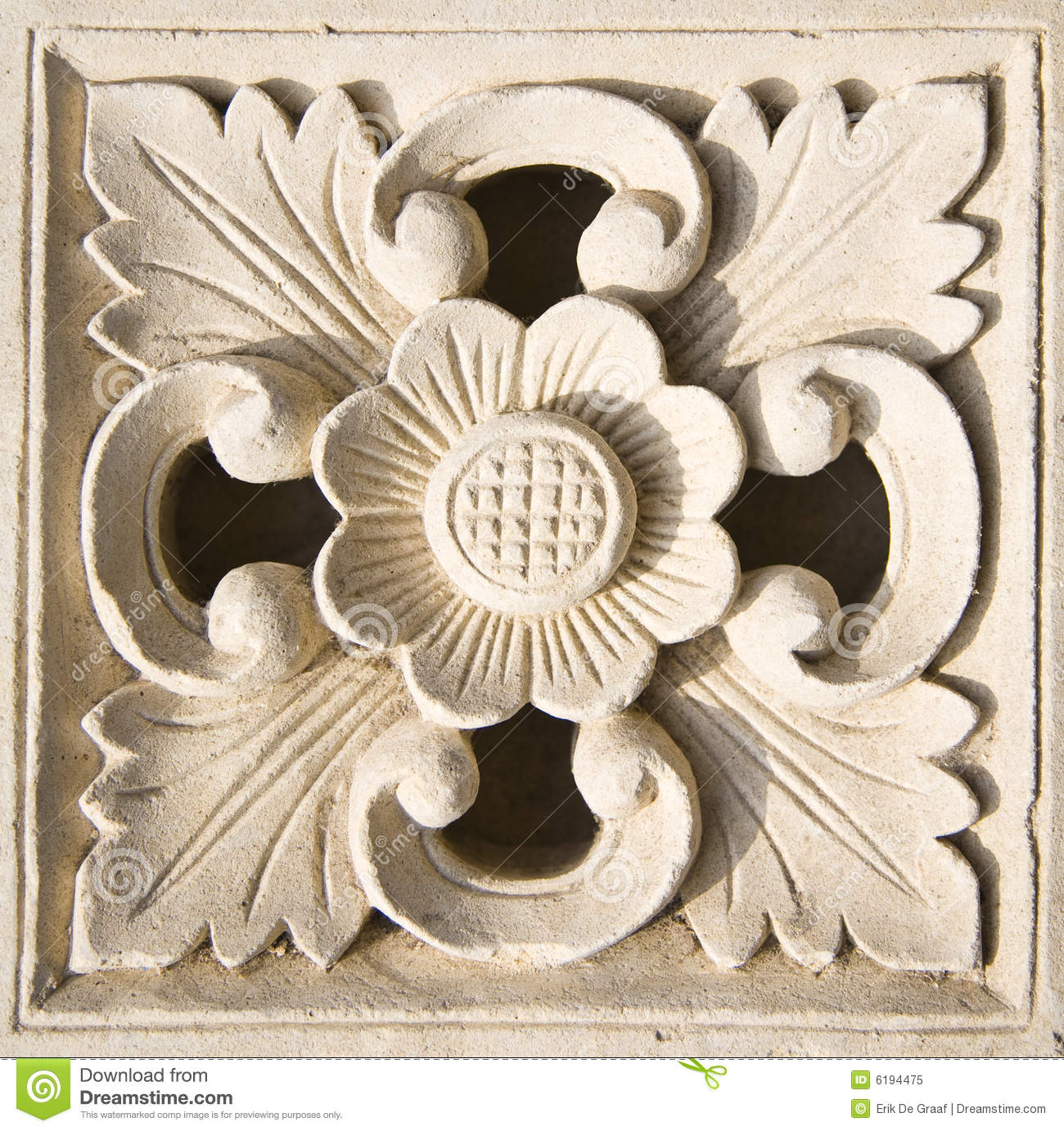 Bali stone carving stock image of flower carve
