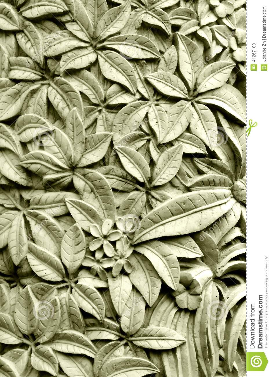 Balinese style stone carving plumeria flowers stock photo