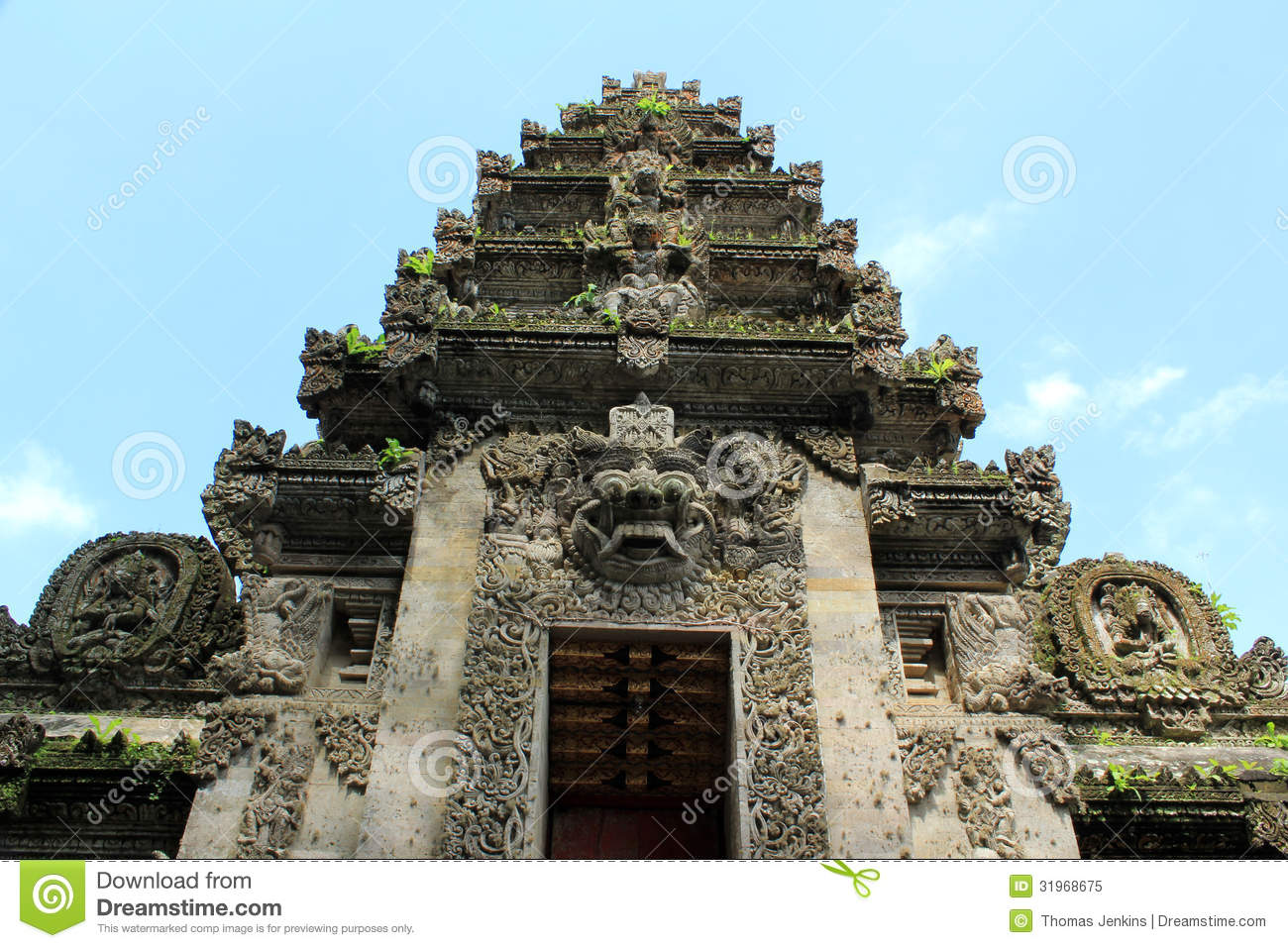 Balinese temple entrance with intricate stone carving