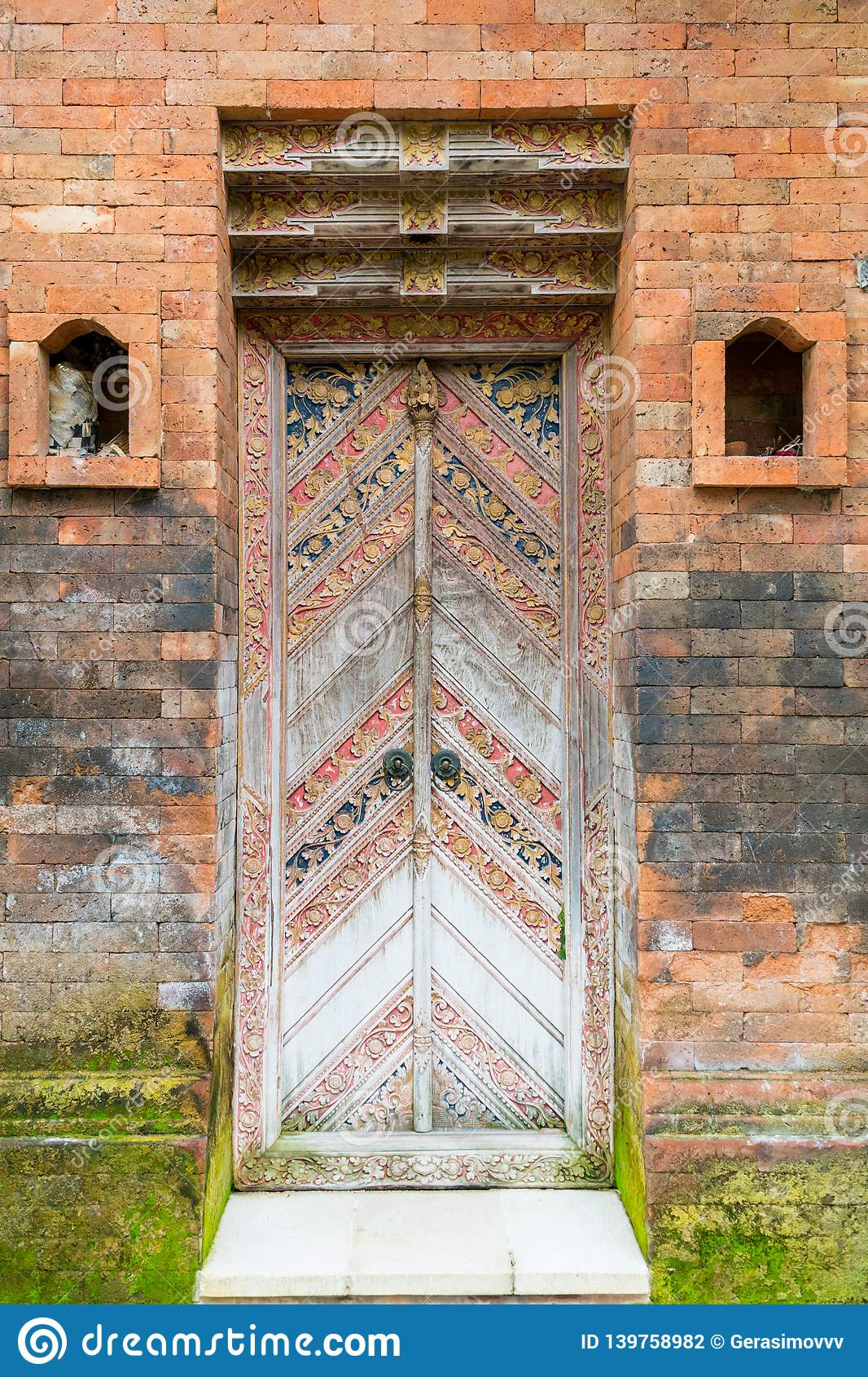 Balinese wood carved doors with traditional local ornaments stock photography