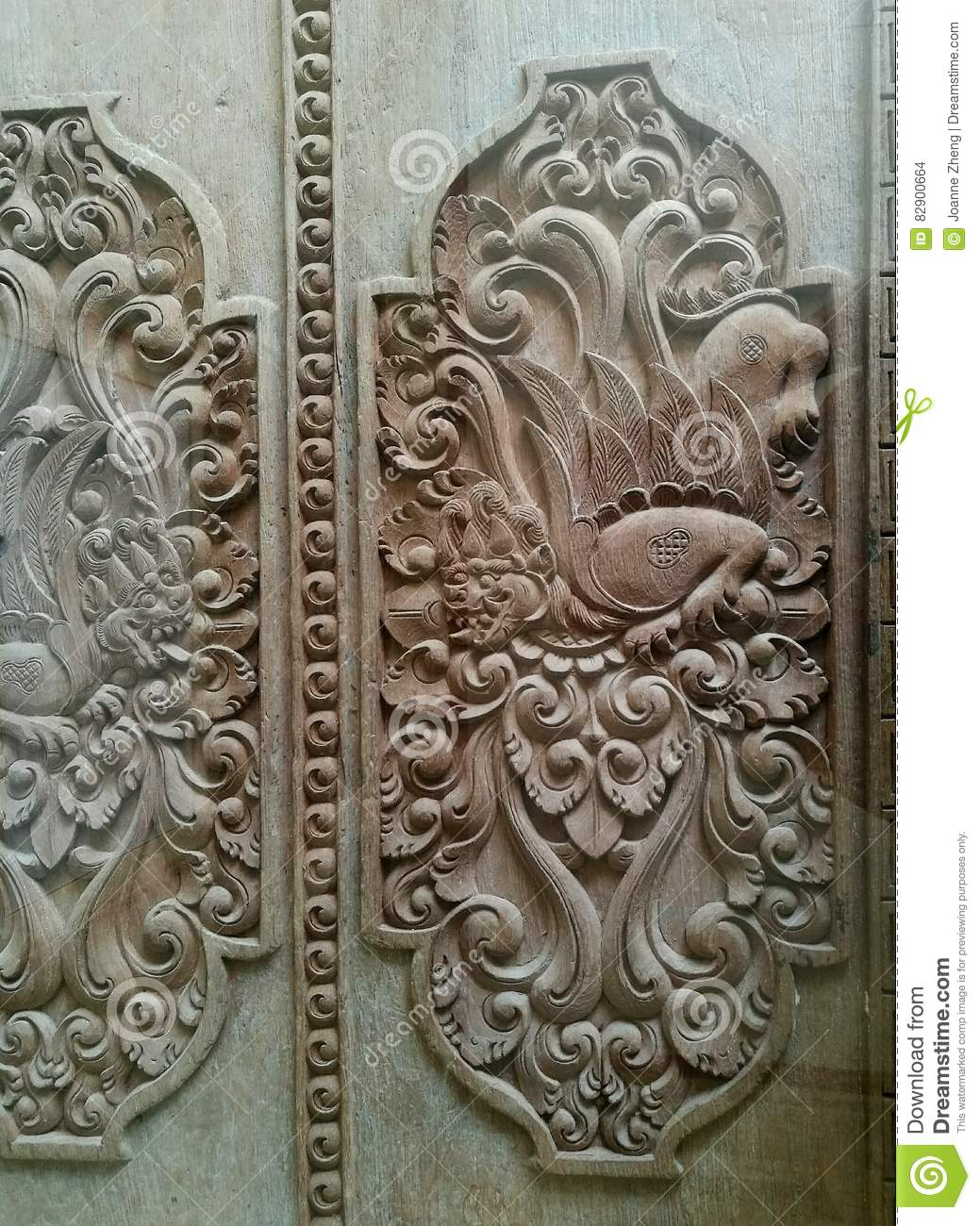 Balinese wood carving art ornate details stock photo