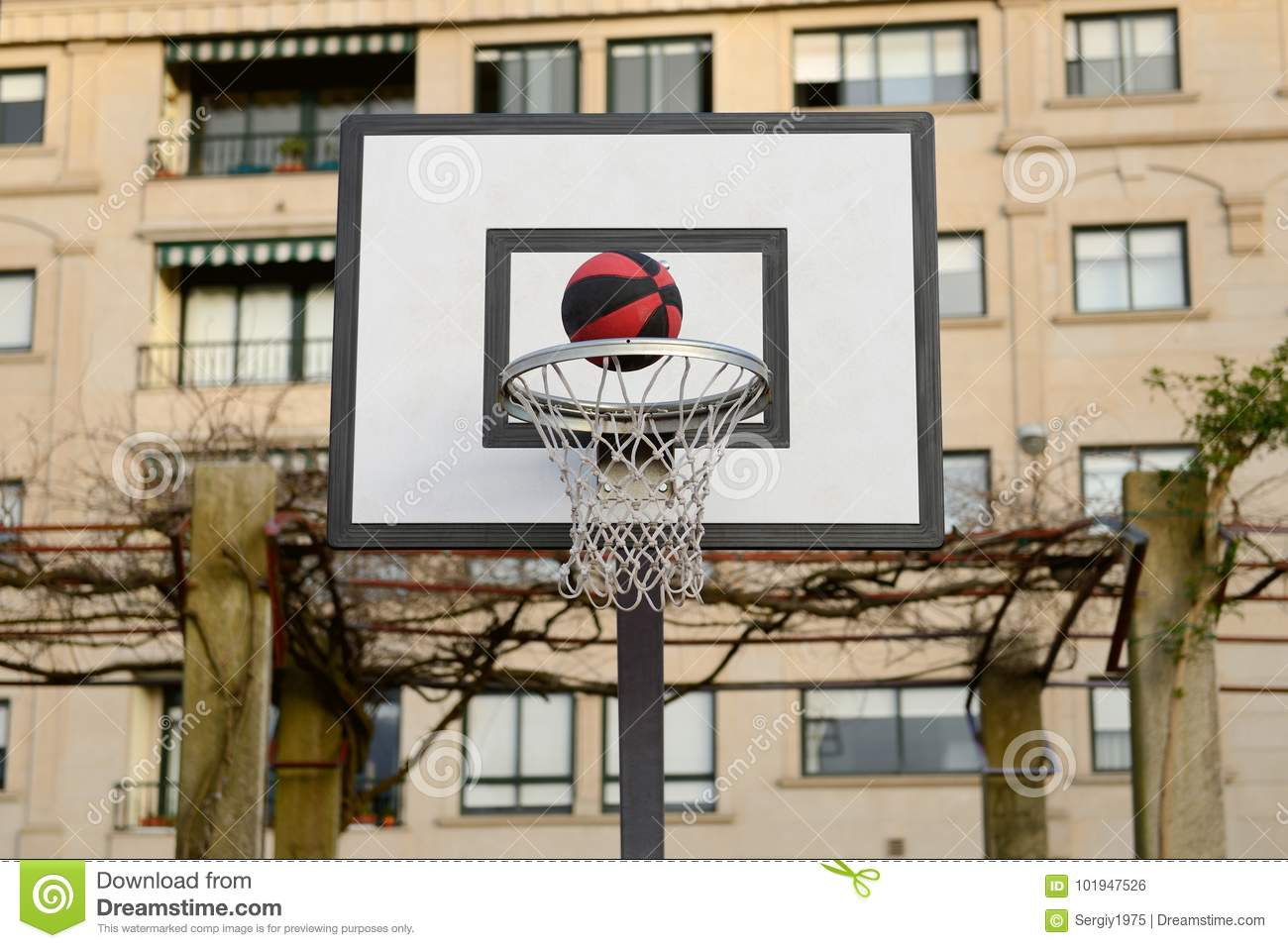 Ball flying into the basketball net
