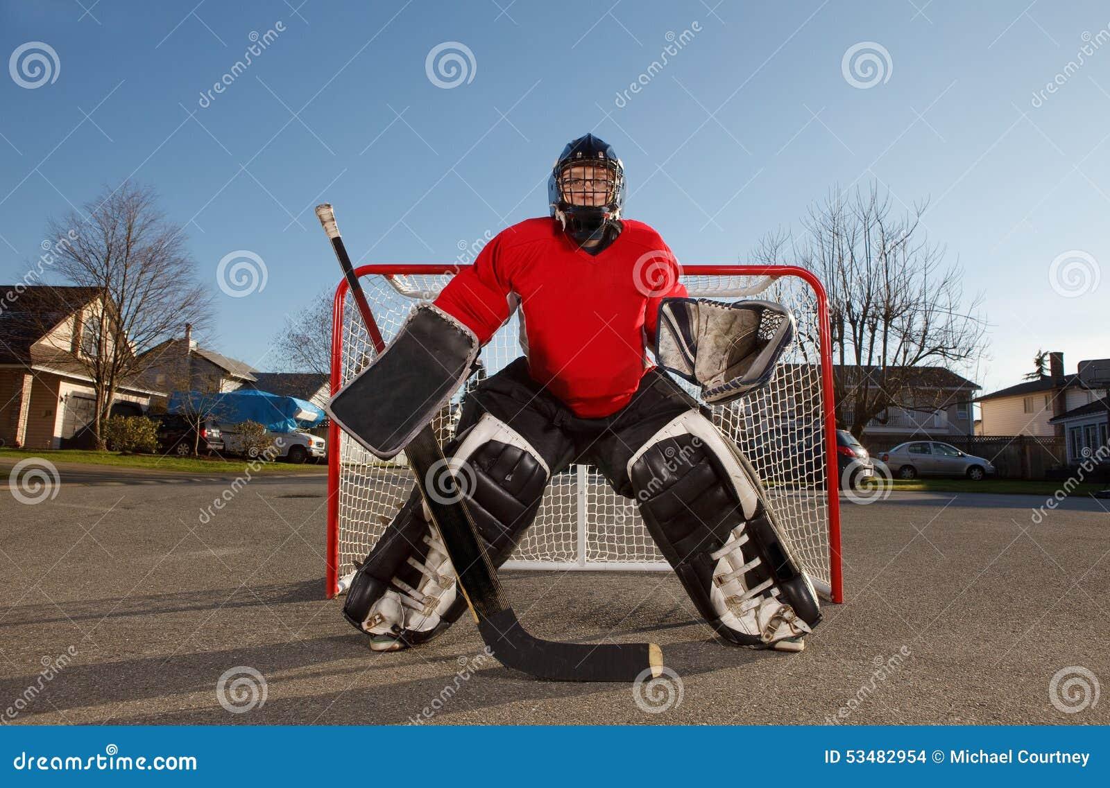 Ball hockey goalie outside in net.