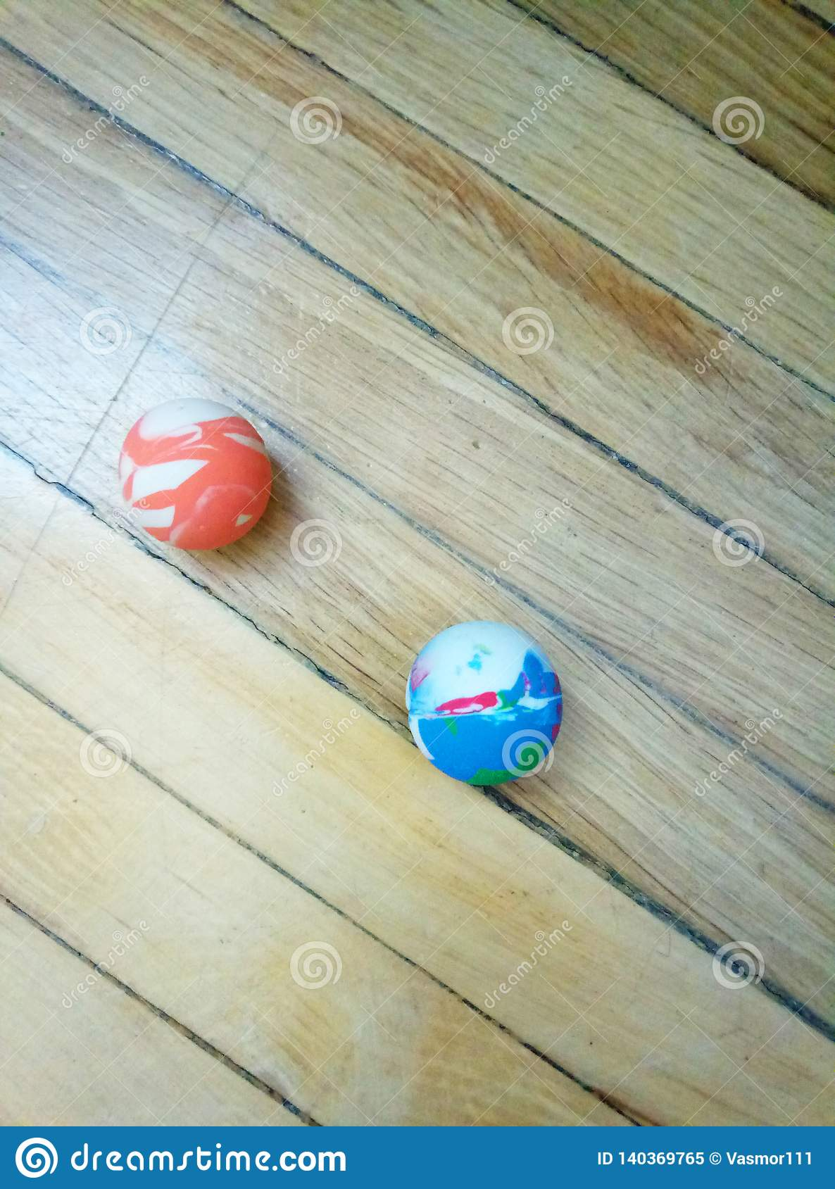 Ball `Jumping` on wooden background