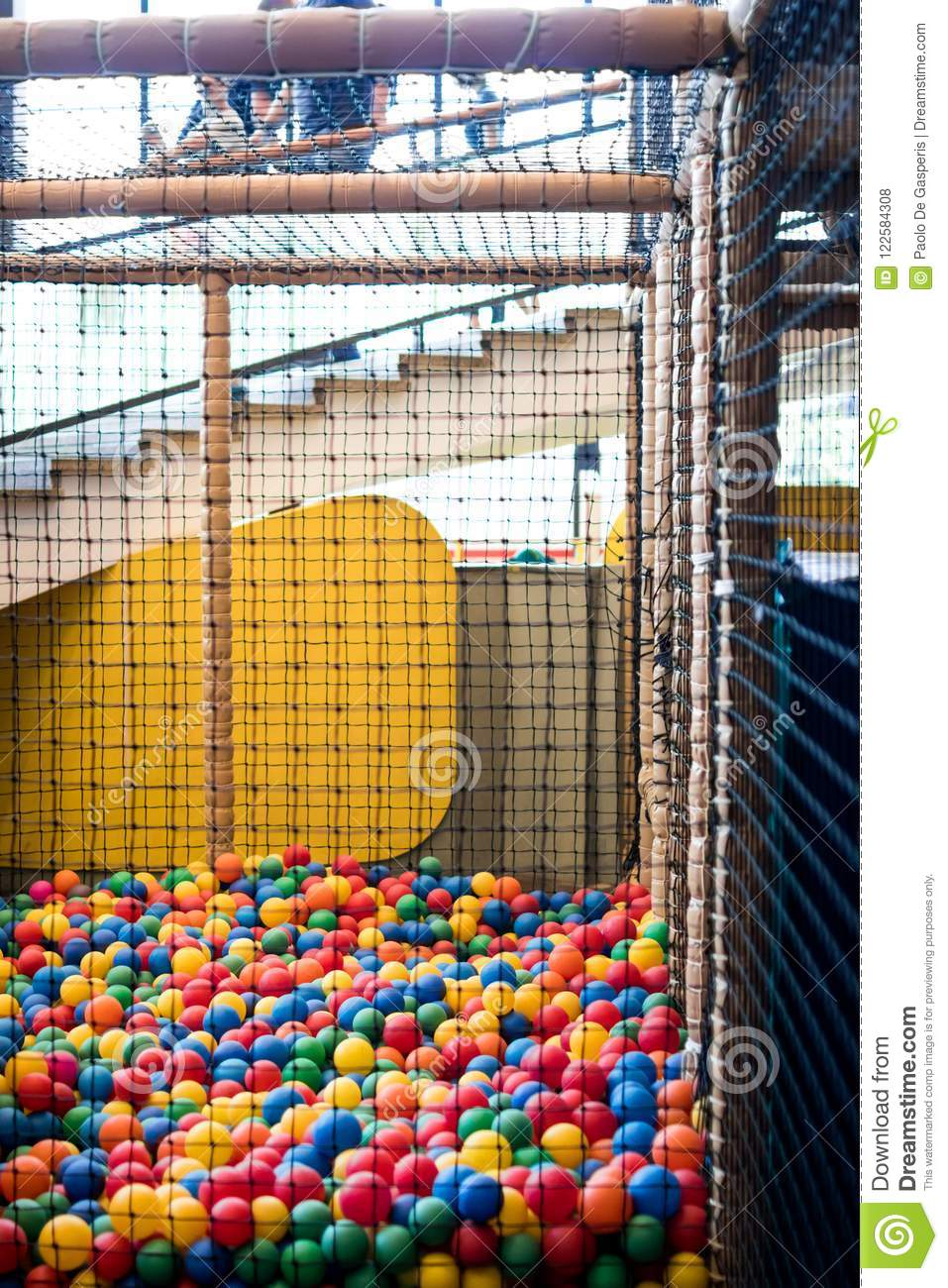 ball pool with a net for children. games for children in the amusement park, amusement area with a pool of colored soft balls, sw