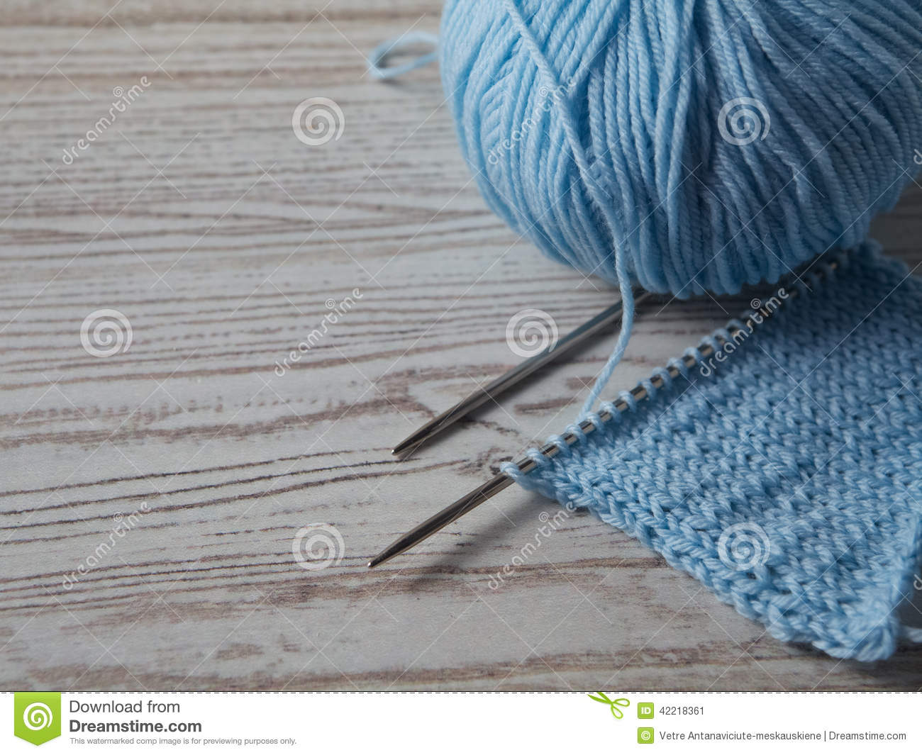 Ball of yarn and knitting on a table for Table knitting