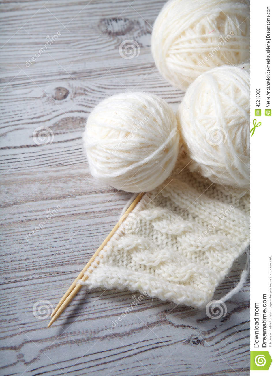 Ball of yarn and knitting on a table stock image image for Table knitting