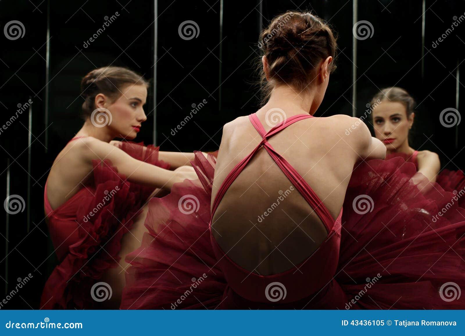 Ballerina dancer looking at the mirror