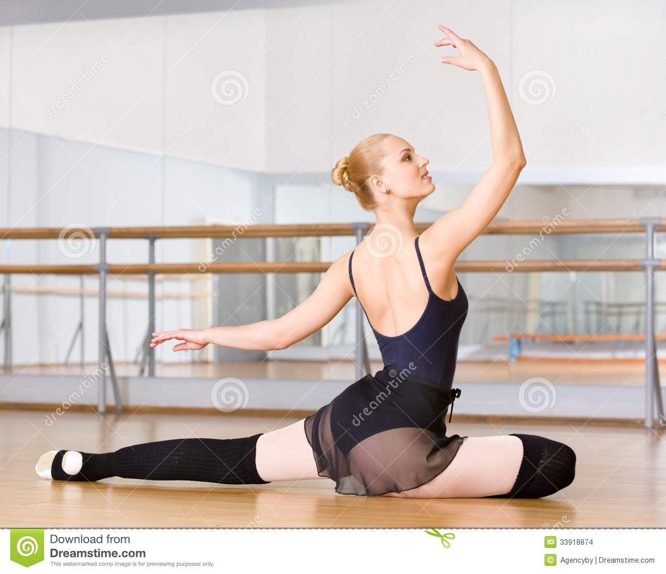 Ballerina does exercises sitting on the floor stock photo for Dance where you sit on the floor