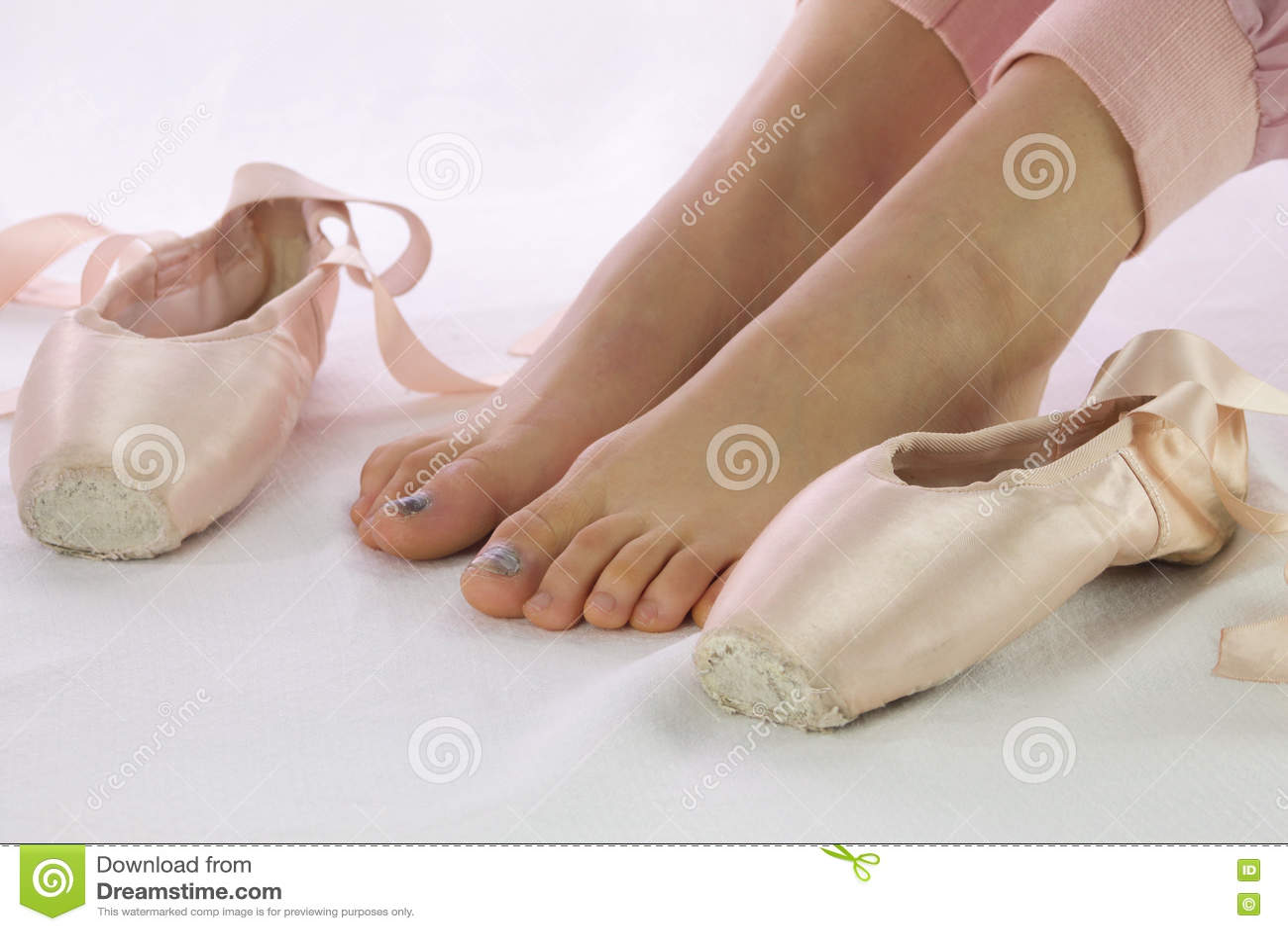 Ballerina feet near pointe shoes isolated