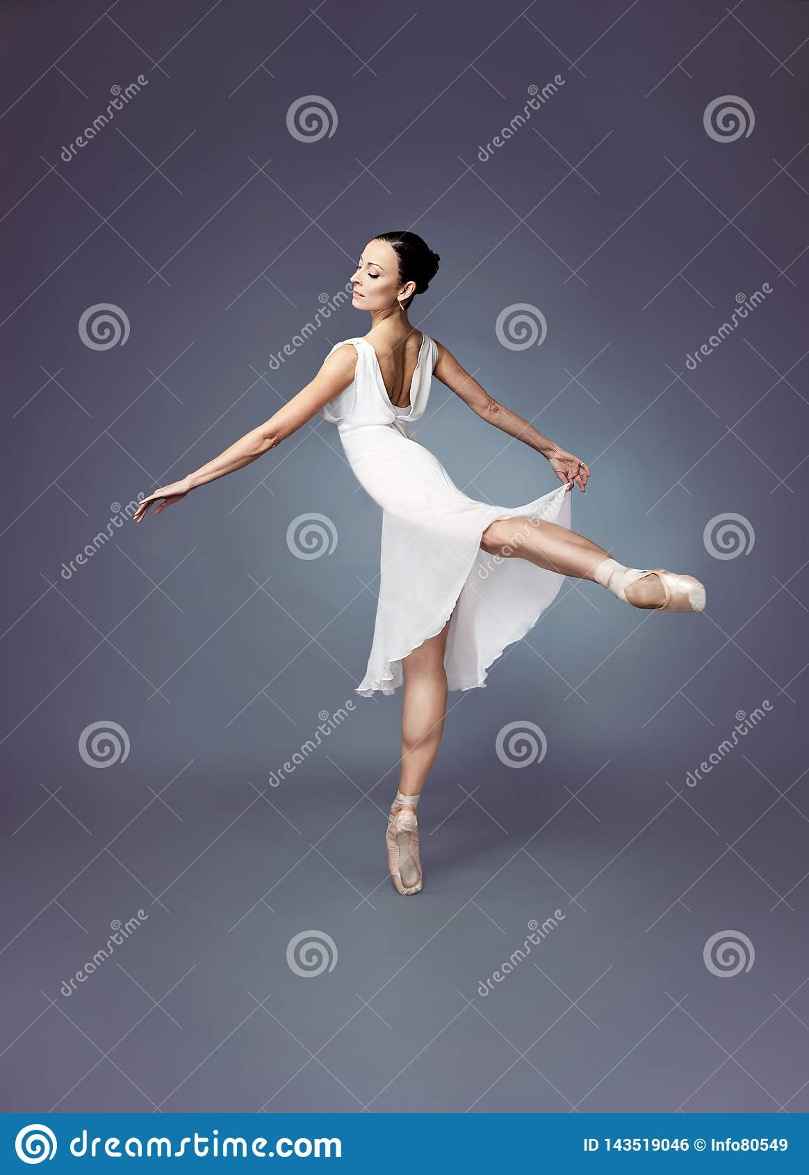 Ballet dancer-Ballerina on point shoes with a white dress