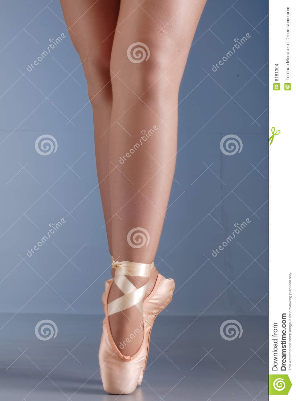 Close up of lady ballet dancer legs and feet, standing on her toes.