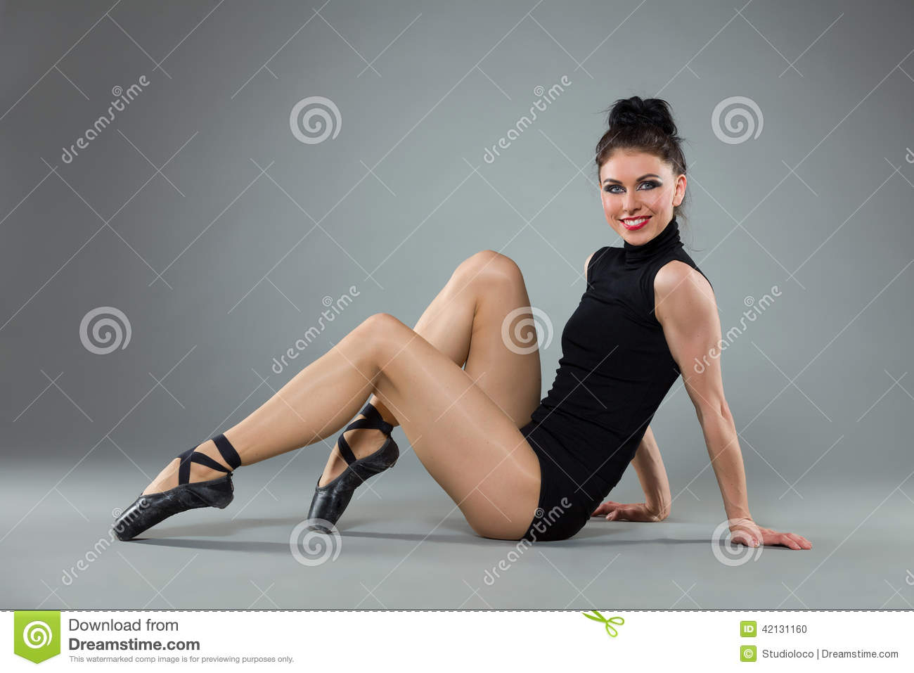 Ballet dancer sitting on the floor stock photo image for On the floor on the floor