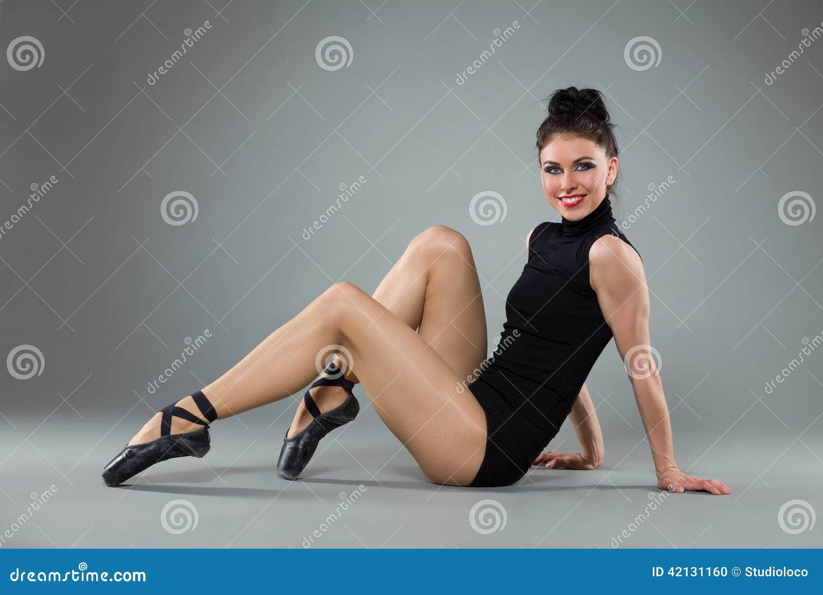 Ballet dancer sitting on the floor stock photo image for On the floor on the floor