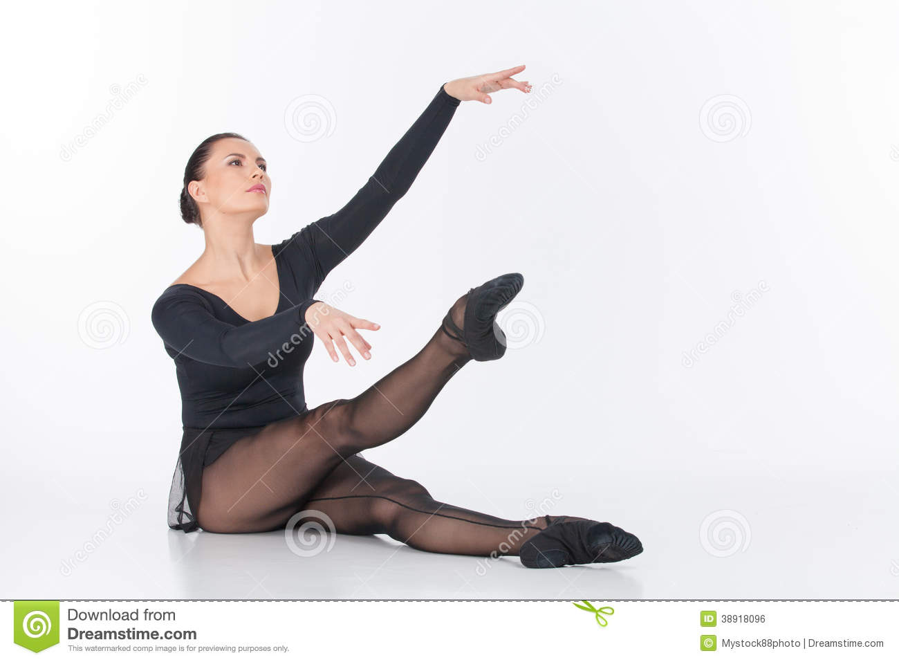 Ballet Dancer Sitting On Floor And Stretching. Stock Photo - Image: 38918096
